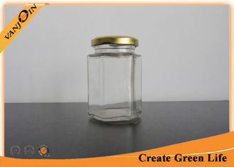 China Screwing Top 200ml Clear Glass Food Jars , Small Hexagon Glass Food Containers with Lids supplier