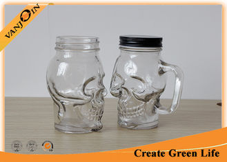 China Clear Skull Head 16oz Mason Glass Jar with Metal Screw Cap / Mason Jar Glasses With Handles supplier